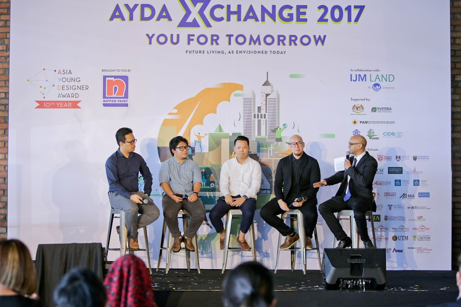 Panel sharing their experience and thoughts at the AYDA XChange session.