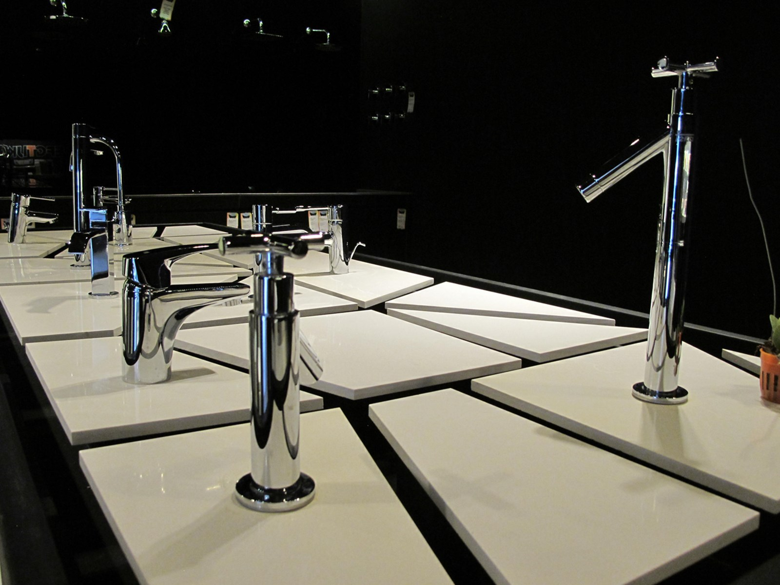 Island counter allows customers to experience and view first hand the flow of water from Teka faucets and mixers.