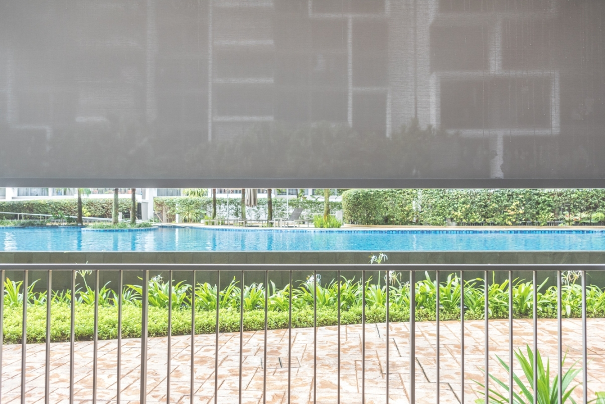 The ALTEX SecureZIP outdoor blinds' height can be adjusted, thus shading the residents from the glaring sunlight while providing them with a view of the pool